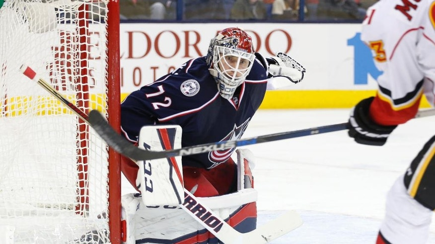 FILE - In this Nov. 23, 2016, file photo, Columbus Blue Jackets' Sergei Bobrovsky, of Russia, plays against the Calgary Flames during an NHL hockey game, in Columbus, Ohio. Since Dec. 3, Metro teams are 28-7-3, led by the Cup champion Pittsburgh Penguins, New York Rangers, red-hot Philadelphia Flyers, Columbus Blue Jackets and streaking Capitals.(AP Photo/Jay LaPrete)