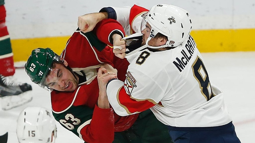 Minnesota Wild's Kurtis Gabriel (63) and Florida Panthers' Dylan McIlrath (8) fight in the first period of an NHL hockey game Tuesday, Dec. 13, 2016, in St. Paul, Minn. (AP Photo/Stacy Bengs)