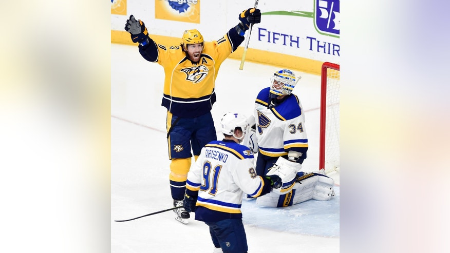 Nashville Predators right wing James Neal (18) celebrates after teammate Ryan Johansen, scored a goal against St. Louis Blues goalie Jake Allen (34) tying the score during the third period of an NHL hockey game, Tuesday, Dec. 13, 2016, in Nashville, Tenn. The Predators won 6-3. (AP Photo/Mark Zaleski)