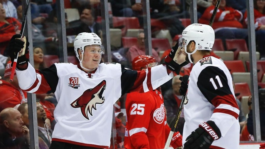 Arizona Coyotes left wing Lawson Crouse (67) celebrates his goal against the Detroit Red Wings with Martin Hanzal (11) in the first period of an NHL hockey game, Tuesday, Dec. 13, 2016, in Detroit. (AP Photo/Paul Sancya)
