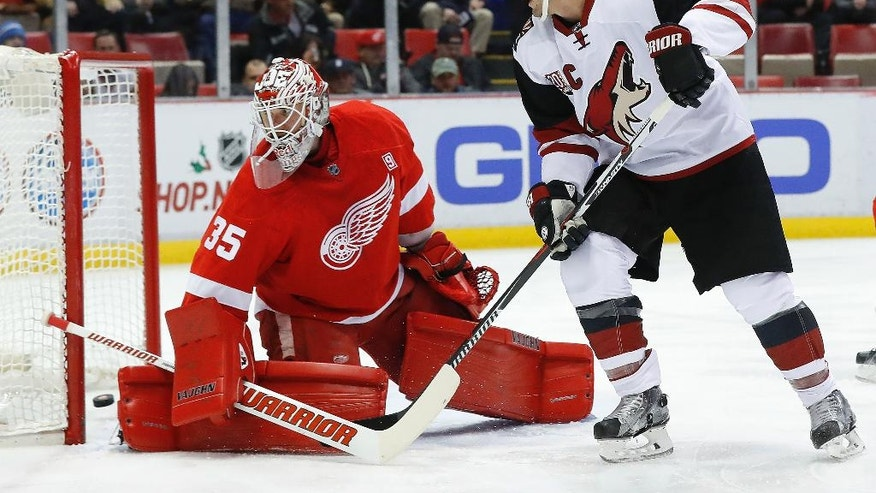 Arizona Coyotes right wing Shane Doan, right, watches an Anthony DeAngelo shot score on Detroit Red Wings goalie Jimmy Howard (35) in the first period of an NHL hockey game, Tuesday, Dec. 13, 2016, in Detroit. (AP Photo/Paul Sancya)