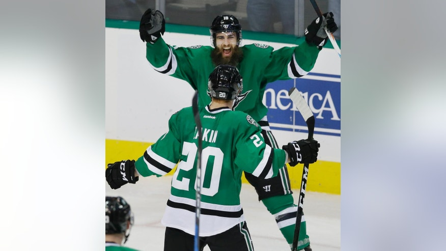 Dallas Stars right wing Patrick Eaves (18) celebrates scoring a goal weigh teammate Cody Eakin (20) during the third period of an NHL hockey game against the Anaheim Ducks in Dallas, Tuesday, Dec. 13, 2016. The Stars won 6-2. (AP Photo/LM Otero)