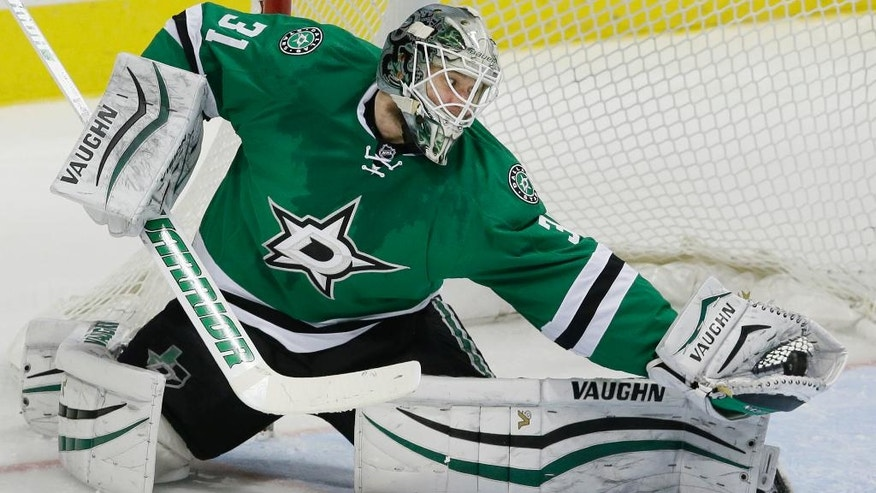 Dallas Stars goalie Antti Niemi (31) catches the puck for a save during the second period of an NHL hockey game against the Anaheim Ducks in Dallas, Tuesday, Dec. 13, 2016. (AP Photo/LM Otero)