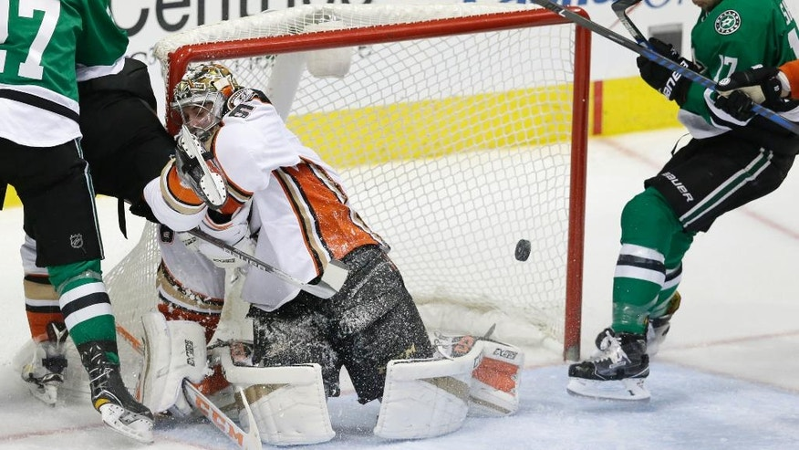 Dallas Stars center Devin Shore (17) scores a goal against Anaheim Ducks goalie John Gibson (36) as Stars right wing Adam Cracknell (27) looks on during the third period of an NHL hockey game in Dallas, Tuesday, Dec. 13, 2016. (AP Photo/LM Otero)