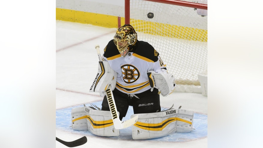 A shot by Pittsburgh Penguins defenseman Justin Schultz (4) goes into the net past Boston Bruins goalie Tuukka Rask (40) for a goal during the first period of an NHL hockey game on Wednesday, Dec. 14, 2016, in Pittsburgh. (AP Photo/Fred Vuich)