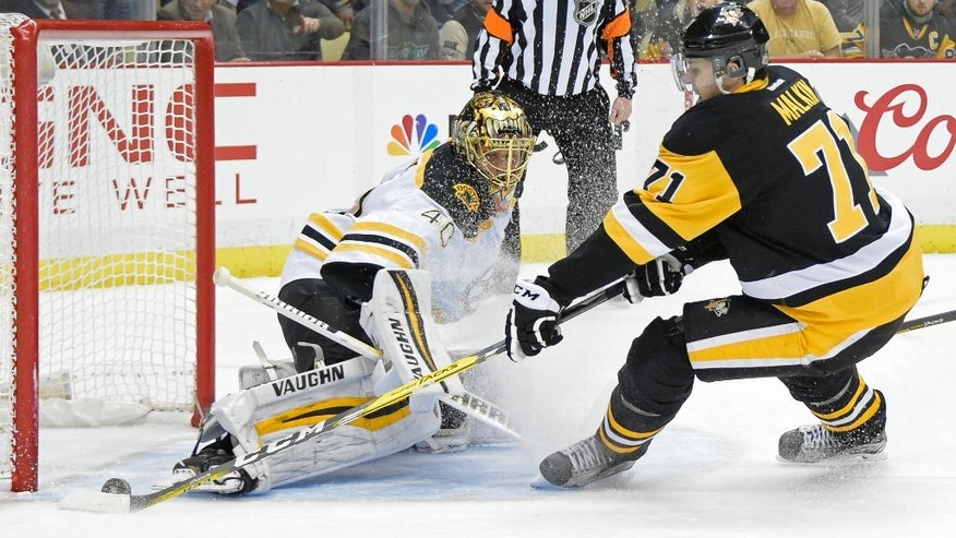 Boston Bruins goalie Tuukka Rask (40) stops a shot by Pittsburgh Penguins center Evgeni Malkin (71) during the second period of an NHL hockey game on Wednesday, Dec. 14, 2016, in Pittsburgh. (AP Photo/Fred Vuich)