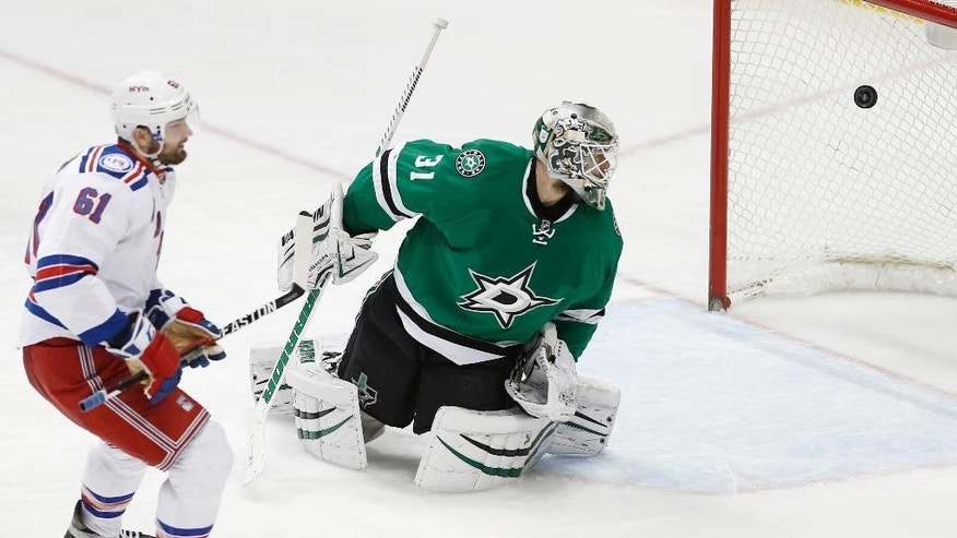 New York Rangers forward Rick Nash (61) scores a breakaway short-handed goal against Dallas Stars goalie Antti Niemi (31) during the third period of an NHL hockey game, Thursday, Dec. 15, 2016, in Dallas. (AP Photo/Brandon Wade)