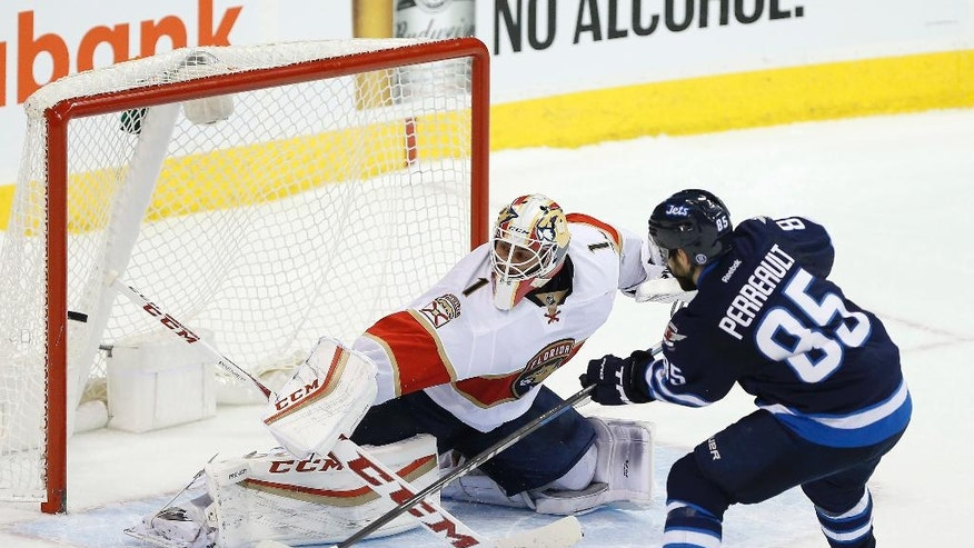 Winnipeg Jets' Mathieu Perreault (85) scores the winning goal against Florida Panthers goaltender Roberto Luongo (1) during the shootout in an NHL hockey game, Thursday, Dec. 15, 2016 in Winnipeg, Manitoba. (John Woods/The Canadian Press via AP)