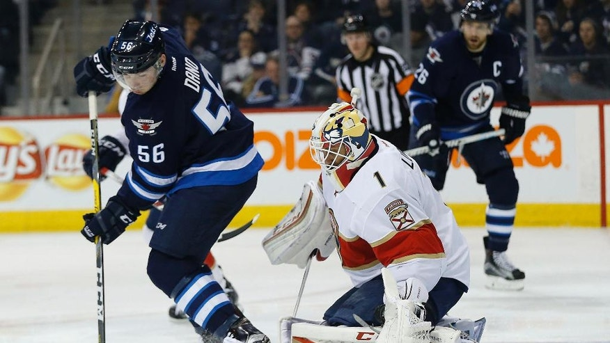 Florida Panthers goaltender Roberto Luongo (1) saves the deflection by Winnipeg Jets' Marko Dano (56)  during the second period of an NHL hockey game, Thursday, Dec. 15, 2016 in Winnipeg, Manitoba. (John Woods/The Canadian Press via AP)