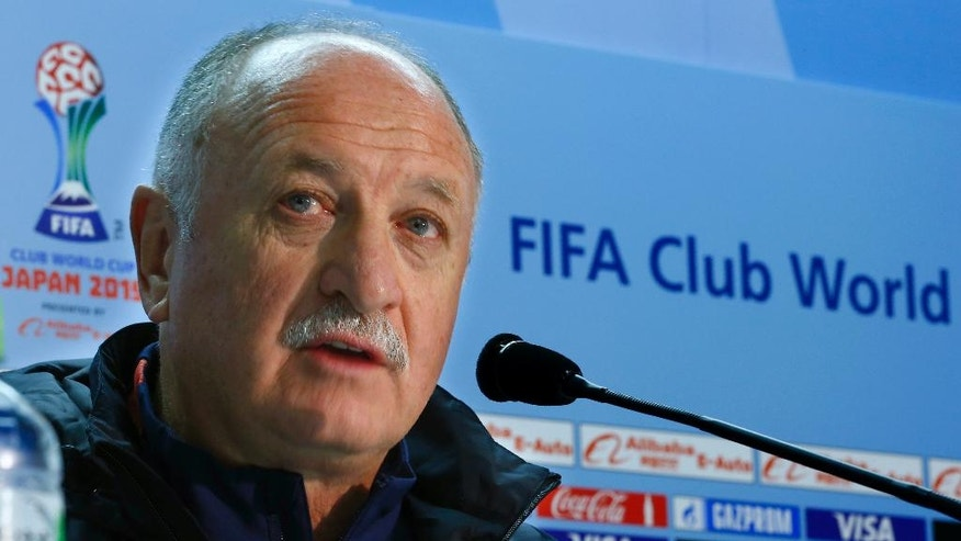FILE - In this Wednesday, Dec. 16, 2015 file photo, Guangzhou Evergrande FC coach Luiz Felipe Scolari of Brazil speaks during a press conference in Yokohama, near Tokyo. World Cup winning coach Scolari's first task in trying to take Guangzhou to a third Asian Champions League will be to face a team coached by a 28 year-old woman. The draw has pitted the Chinese powerhouse against Hong Kong club Eastern F.C., whose coach Chan Yuen-ting became the first woman to lead a men's team to a title in a professional top flight league when Eastern won the 2016 Hong Kong Premier League. (AP Photo/Shizuo Kambayashi, File)