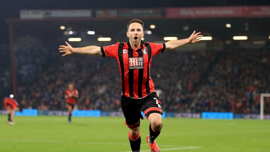 Bournemouth's Marc Pugh celebrates scoring his side's first goal of the game against Leicester City during their English Premier League soccer match at the Vitality Stadium in Bournemouth, England, Tuesday Dec. 13, 2016. (Adam Davy / PA via AP)