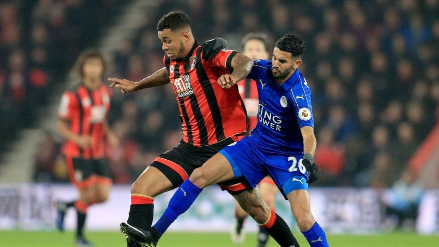 Leicester City's Riyad Mahrez, right, and Bournemouth's Joshua King, chase the ball during their English Premier League soccer match at the Vitality Stadium in Bournemouth, England, Tuesday Dec. 13, 2016. (Adam Davy / PA via AP)