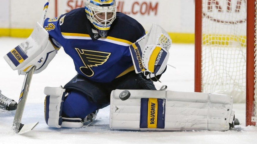 St. Louis Blues goalie Jake Allen makes a pad-save in the first period of an NHL hockey game against the Chicago Blackhawks, Saturday, Dec. 17, 2016, in St. Louis. (AP Photo/Tom Gannam)