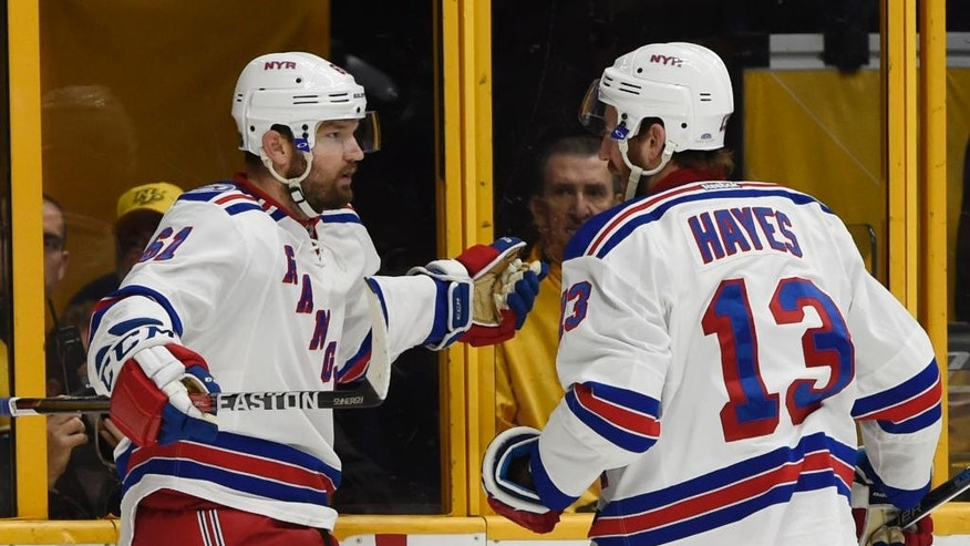 New York Rangers right wing Rick Nash (61), left, celebrates his goal with center Kevin Hayes (13) during the first period of an NHL hockey game Saturday, Dec. 17, 2016, in Nashville, Tenn. (AP Photo/Sanford Myers)