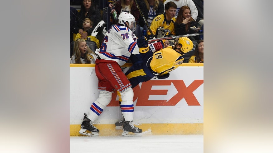 New York Rangers defenseman Brady Skjei (76) puts a big hit on Nashville Predators center Calle Jarnkrok (19), of Sweden, during the second period of an NHL hockey game Saturday, Dec. 17, 2016, in Nashville, Tenn. (AP Photo/Sanford Myers)