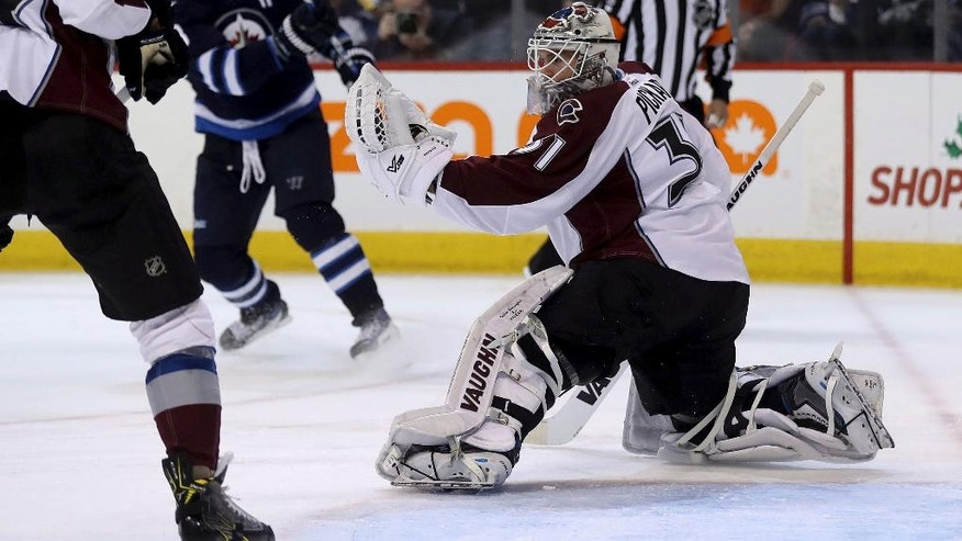 Winnipeg Jets' Dustin Byfuglien (33) is stopped by Colorado Avalanche goaltender Calvin Pickard (31) during the second period of an NHL hockey game, Sunday, Dec. 18, 2016 in Winnipeg, Manitoba. (Trevor Hagan/The Canadian Press via AP)