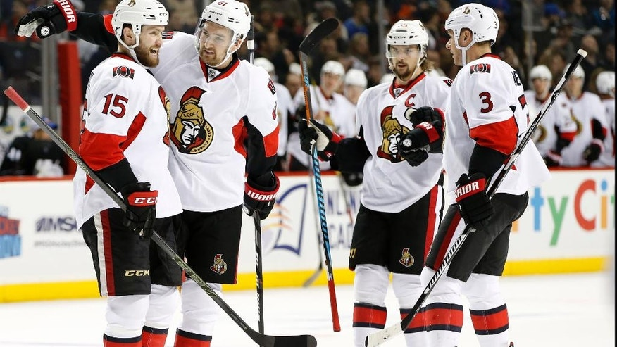 Ottawa Senators' right wing Mark Stone (61) celebrates with Senators' center Zack Smith (15) after Smith scored a goal during the first period of an NHL hockey game, Sunday, Dec. 18, 2016, in New York. (AP Photo/Kathy Willens)
