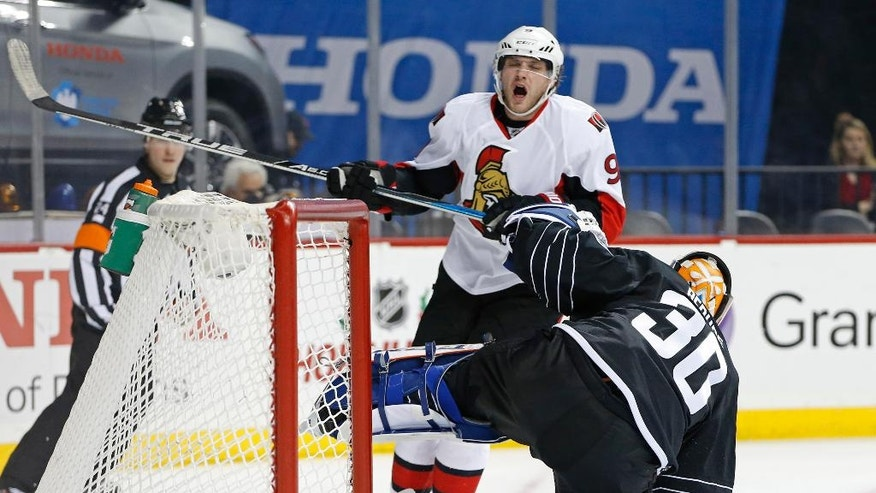 Ottawa Senators right wing Bobby Ryan (9) reacts after he was hit on the hand while scoring a goal on New York Islanders goalie Jean-Francois Berube (30) during the first period of an NHL hockey game, Sunday, Dec. 18, 2016, in New York. (AP Photo/Kathy Willens)