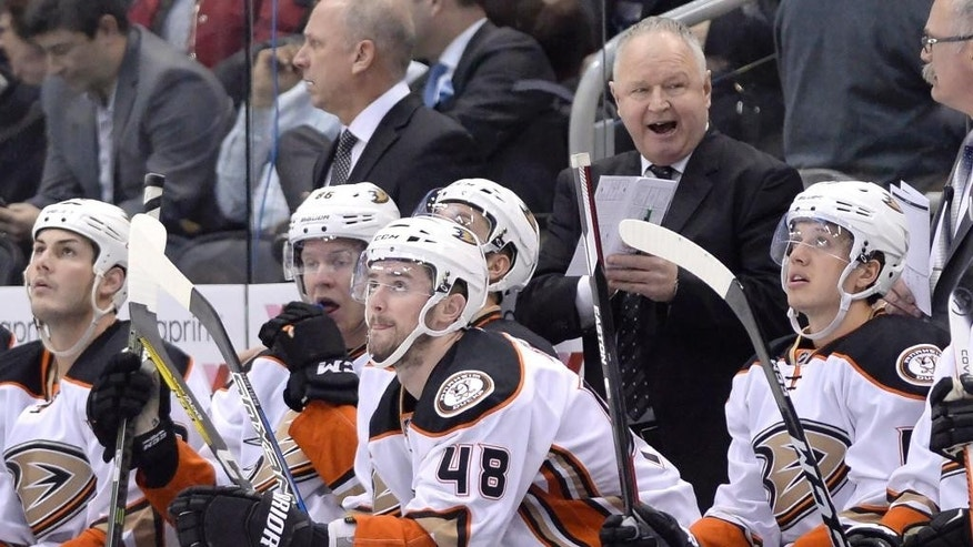 Anaheim Ducks head coach Randy Carlyle, former head coach of the Toronto Maple Leafs, looks on during the third period of an NHL hockey game in Toronto, Monday, Dec. 19, 2016. (Nathan Denette/The Canadian Press via AP)