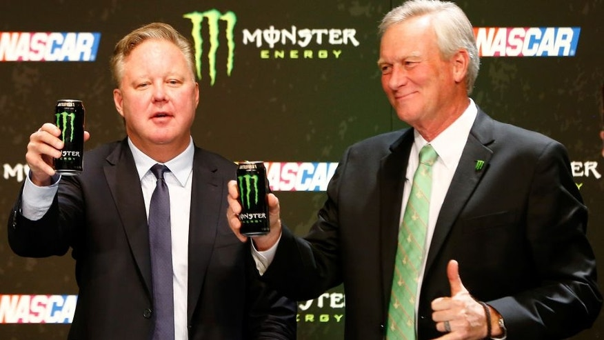 LAS VEGAS, NV - DECEMBER 01: Brian France, NASCAR Chairman and CEO, and Mark Hall, Chief Marketing Officer of Monster Beverage Co., toast during a press conference as NASCAR and Monster Energy announce premier series entitlement partnership at Wynn Las Vegas on December 1, 2016 in Las Vegas, Nevada. Monster Energy, which will begin its tenure as naming rights partner on Jan. 1, 2017, will become only the third company to serve as the entitlement sponsor in NASCAR premier series history, following RJ Reynolds and Sprint/Nextel. (Photo by Jonathan Ferrey/Getty Images)