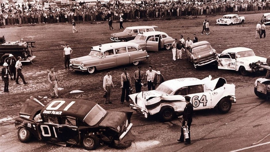 DAYTONA BEACH, FL - FEBRUARY 13, 1960: In the foreground are two victims of the 1960 modified-sportsman race at Daytona, which produced a 37-car pile-up on lap two. Sonny Palmer (No. 01), and Earl Balmer (No. 64) were aboard the '57 Chevies. (Photo by ISC Archives via Getty Images)