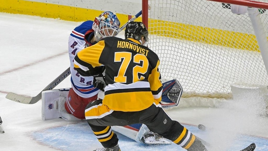 Pittsburgh Penguins right wing Patric Hornqvist (72) slides the puck past New York Rangers goalie Henrik Lundqvist (30) for a goal during the third period of an NHL hockey game Tuesday, Dec. 20, 2016, in Pittsburgh. (AP Photo/Fred Vuich)