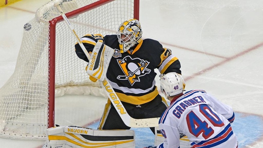 New York Rangers right wing Michael Grabner (40) scores a goal on Pittsburgh Penguins goalie Matt Murray (30) during the third period of an NHL hockey game Tuesday, Dec. 20, 2016, in Pittsburgh. (AP Photo/Fred Vuich)