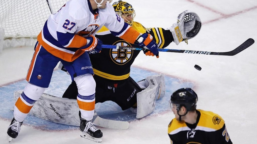 New York Islanders left wing Anders Lee (27) tips the puck down in front of Boston Bruins goalie Anton Khudobin, which set up his goal, during the third period of an NHL hockey game in Boston, Tuesday, Dec. 20, 2016. (AP Photo/Charles Krupa)