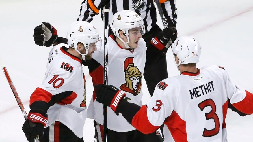 Ottawa Senators' Tom Pyatt (10) celebrates his goal with Marc Methot (3) and Jean-Gabriel Pageau during the second period of an NHL hockey game against the Chicago Blackhawks, Tuesday, Dec. 20, 2016, in Chicago. (AP Photo/Charles Rex Arbogast)