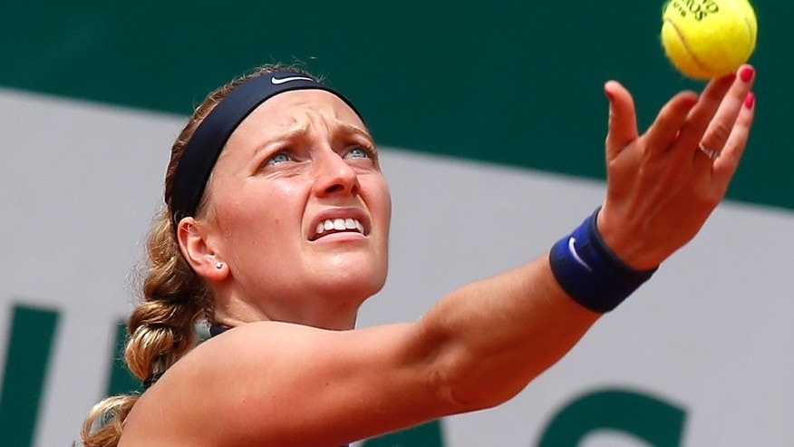 FILE - In this May 27, 2016 file photo, Petra Kvitova of the Czech Republic serves in her third round match of the French Open tennis tournament against Shelby Rogers of the U.S. at the Roland Garros stadium in Paris.