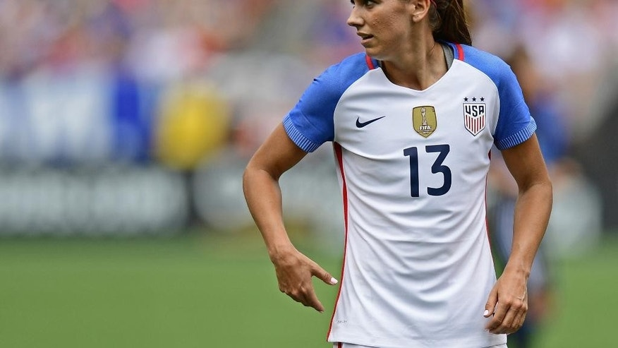 FILE - In this Sunday, June 5, 2016 file photo, United States forward Alex Morgan stands during the first half of an international friendly soccer match against Japan in Cleveland, Ohio. United States forward Alex Morgan has joined Lyon from Orlando Pride on a six-month deal with an option for a further season. The highly successful French club announced the loan move in a statement on Tuesday, Dec. 20, 2016. (AP Photo/David Dermer, file)