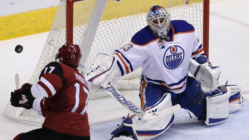 Edmonton Oilers goalie Cam Talbot makes the save on Arizona Coyotes right wing Radim Vrbata (17) in the second period during an NHL hockey game, Wednesday, Dec. 21, 2016, in Glendale, Ariz. (AP Photo/Rick Scuteri)
