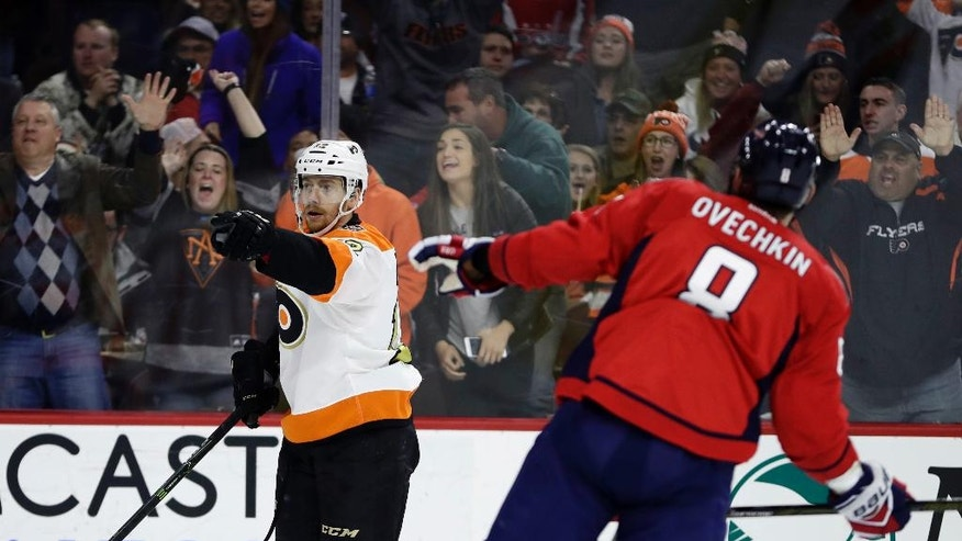 Philadelphia Flyers' Michael Raffl, left, reacts past Washington Capitals' Alex Ovechkin after Raffl's goal during the second period of an NHL hockey game, Wednesday, Dec. 21, 2016, in Philadelphia. (AP Photo/Matt Slocum)
