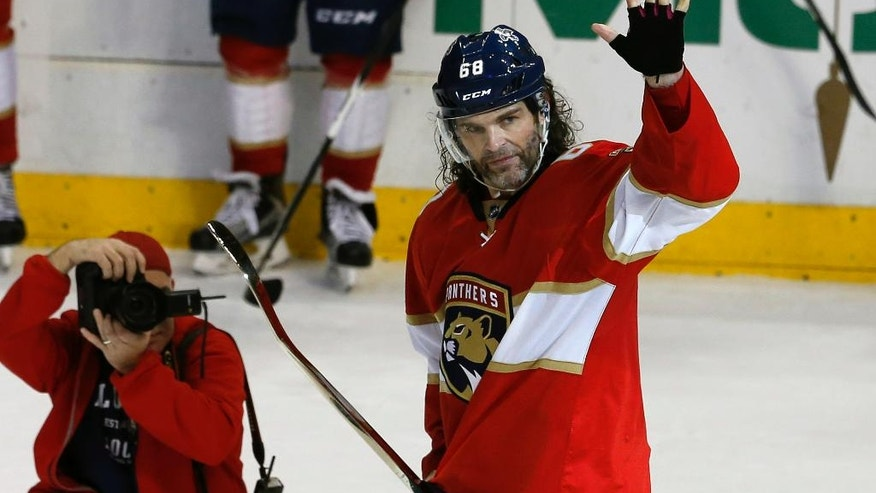 Florida Panthers right wing Jaromir Jagr (68) waves to the crowd after being presented with a golden stick after his assist, giving him 1,888 goals, second most in NHL history during the third period of play against the Boston Bruins in an NHL hockey game, Thursday, Dec. 22, 2016, in Sunrise, Fla. (AP Photo/Joe Skipper)