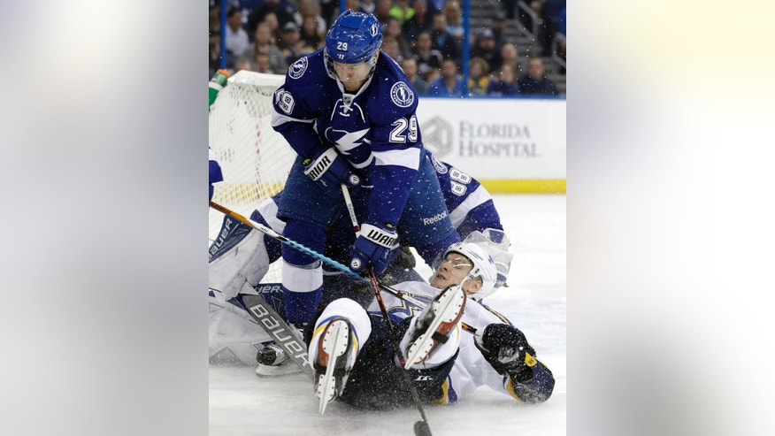 Tampa Bay Lightning defenseman Slater Koekkoek (29) takes down St. Louis Blues defenseman Colton Parayko (55) during the first period of an NHL hockey game Thursday, Dec. 22, 2016, in Tampa, Fla. (AP Photo/Chris O'Meara)