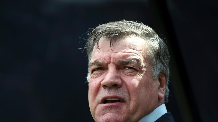 "FILE - In this Sunday, May 24, 2015 file photo, Sam Allardyce waits at the start of the English Premier League soccer match between Newcastle United and West Ham United's at St James' Park, Newcastle, England. Former England manager Sam Allardyce has arrived at Crystal Palace's training ground and says he will ""complete talks"" with the club's chairman regarding its managerial vacancy. Allardyce is the favorite to take over at Palace following the firing of Alan Pardew on Thursday Dec. 22, 2016. (AP Photo/Scott Heppell, file)"