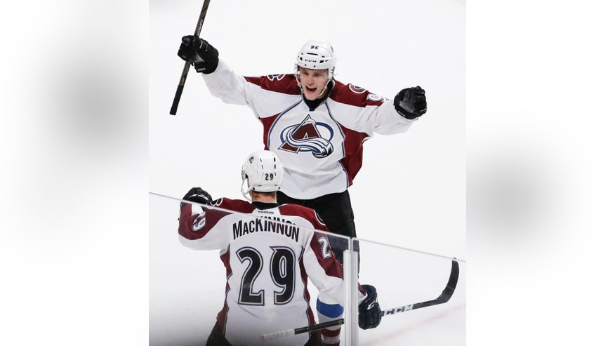 Colorado Avalanche center Nathan MacKinnon (29) celebrates with teammate right wing Mikko Rantanen (96) after scoring in overtime against the Chicago Blackhawks during an NHL hockey game Friday, Dec. 23, 2016, in Chicago. The Avalanche won 2-1. (AP Photo/Kamil Krzaczynski)