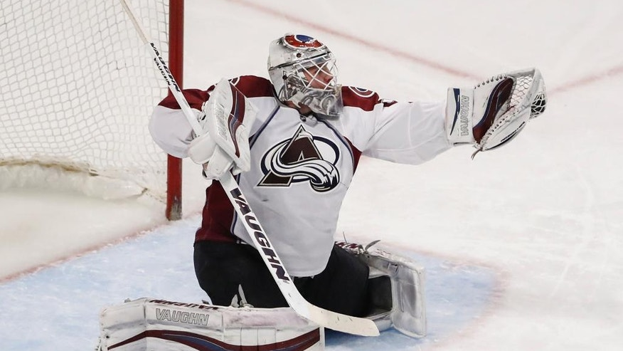 Colorado Avalanche goalie Calvin Pickard defends against the Chicago Blackhawks during the third period of an NHL hockey game Friday, Dec. 23, 2016, in Chicago. (AP Photo/Kamil Krzaczynski)