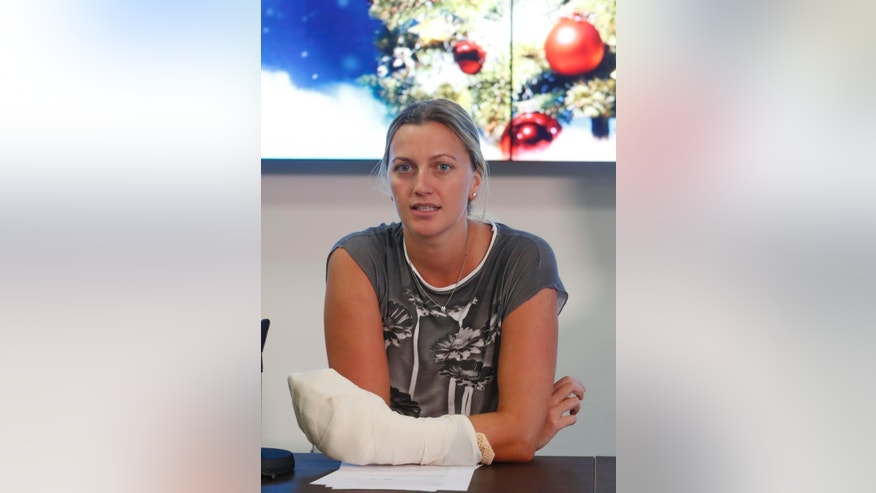 Czech Republic's tennis player Petra Kvitova holds a statement for media in Prague, Czech Republic, Friday, Dec. 23, 2016. Two-time Wimbledon champion was injured Tuesday Dec. 20, 2016 when a knife-wielding intruder attacked her at her home in the town of Prostejov. Kvitova underwent nearly four hour surgery on her left hand. (AP Photo/Petr David Josek)