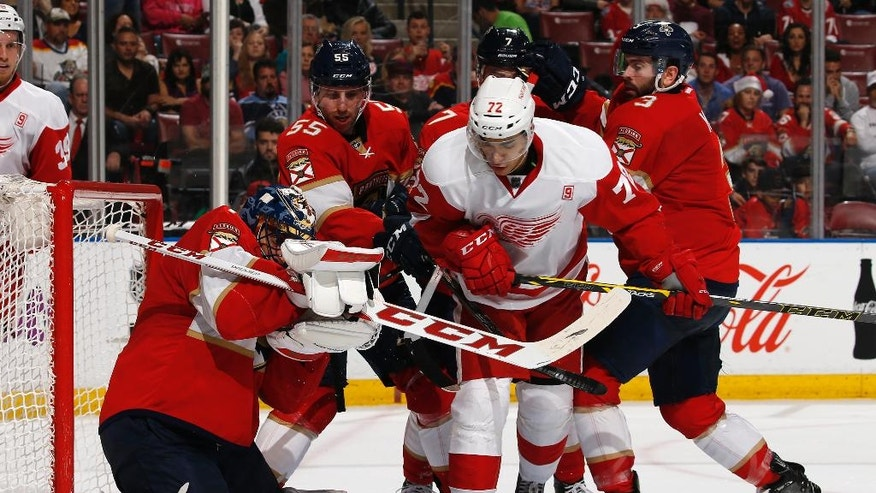 Florida Panthers goaltender Roberto Luongo (1) stops a shot by Detroit Red Wings center Andreas Athanasiou (72) during the second period of an NHL hockey game, Friday, Dec. 23, 2016, in Sunrise, Fla. (AP Photo/Joel Auerbach)