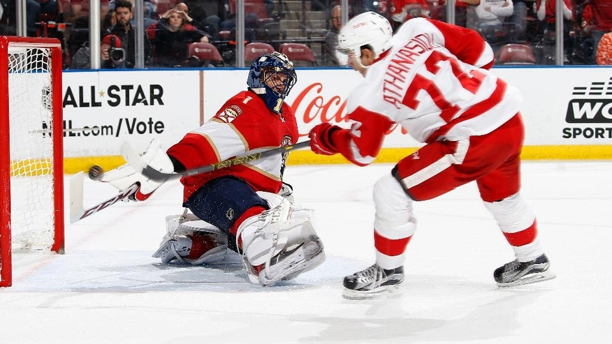 Florida Panthers goaltender Roberto Luongo (1) stop a shot by Detroit Red Wings center Andreas Athanasiou (72) during the second period of an NHL hockey game, Friday, Dec. 23, 2016, in Sunrise, Fla. (AP Photo/Joel Auerbach)