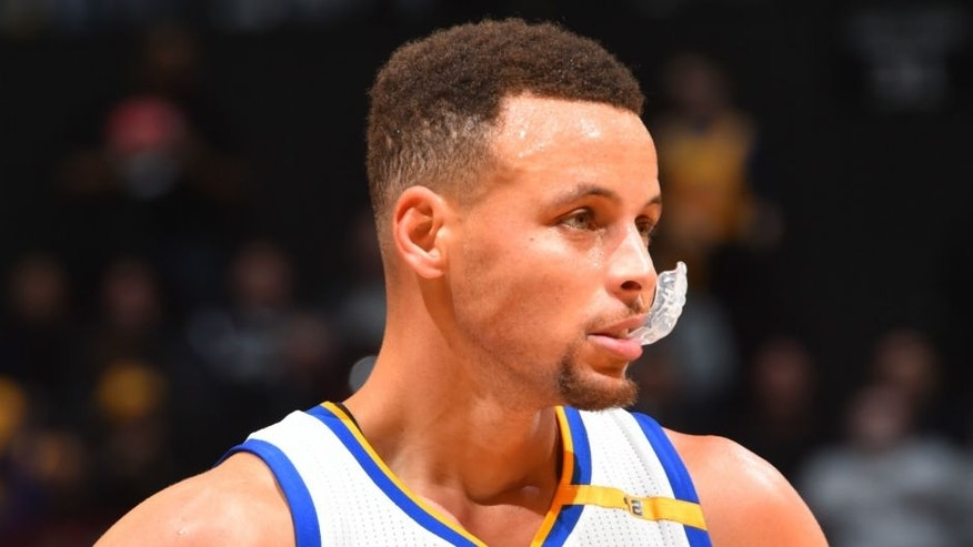 BROOKLYN, NY - DECEMBER 22: Stephen Curry #30 of the Golden State Warriors looks on against the Brooklyn Nets on December 22,2016 at Barclays Center in Brooklyn, New York. NOTE TO USER: User expressly acknowledges and agrees that, by downloading and or using this Photograph, user is consenting to the terms and conditions of the Getty Images License Agreement. Mandatory Copyright Notice: Copyright 2016 NBAE (Photo by Jesse D. Garrabrant/NBAE via Getty Images)