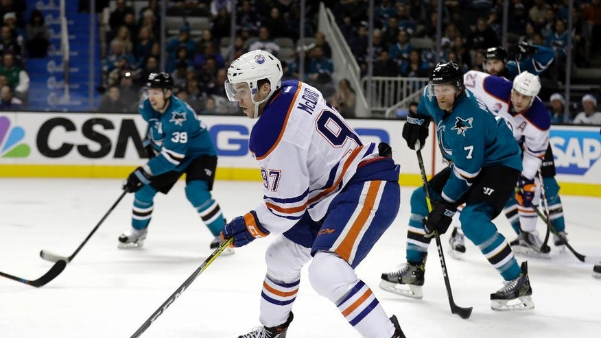 Edmonton Oilers' Connor McDavid (97) controls the puck against the San Jose Sharks during the second period of an NHL hockey game Friday, Dec. 23, 2016, in San Jose, Calif. (AP Photo/Marcio Jose Sanchez)