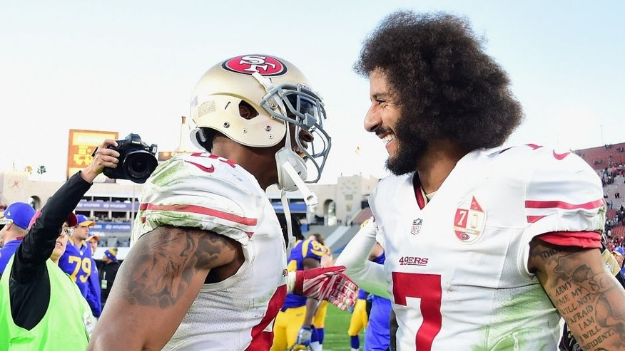 LOS ANGELES, CA - DECEMBER 24: Rod Streater #81 and Colin Kaepernick #7 of the San Francisco 49ers celebrate after defeating the Los Angeles Rams 22-21 at Los Angeles Memorial Coliseum on December 24, 2016 in Los Angeles, California. (Photo by Harry How/Getty Images)