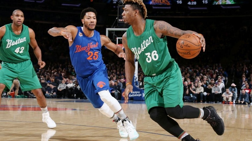 NEW YORK CITY - DECEMBER 25: Marcus Smart #36 of the Boston Celtics drives during a game against Derrick Rose #25 of the New York Knicks on December 25, 2016 at Madison Square Garden in New York, New York. NOTE TO USER: User expressly acknowledges and agrees that, by downloading and/or using this Photograph, user is consenting to the terms and conditions of the Getty Images License Agreement. Mandatory Copyright Notice: Copyright 2016 NBAE (Photo by Nathaniel S. Butler/NBAE via Getty Images)