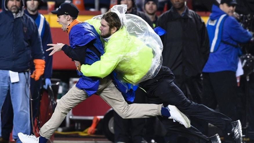 KANSAS CITY, MO: DECEMBER 25: A fan gets tackled by a security guard after running out on to the field during the third quarter to stop play during the Denver Broncos Kansas City Chiefs game December 25, 2016 at Arrowhead Stadium. (Photo By John Leyba/The Denver Post via Getty Images)