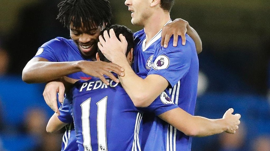 Chelsea's Pedro, center, celebrates with teammates after scoring during the English Premier League soccer match between Chelsea and Bournemouth at Stamford Bridge stadium in London, Monday, Dec. 26, 2016.(AP Photo/Frank Augstein)