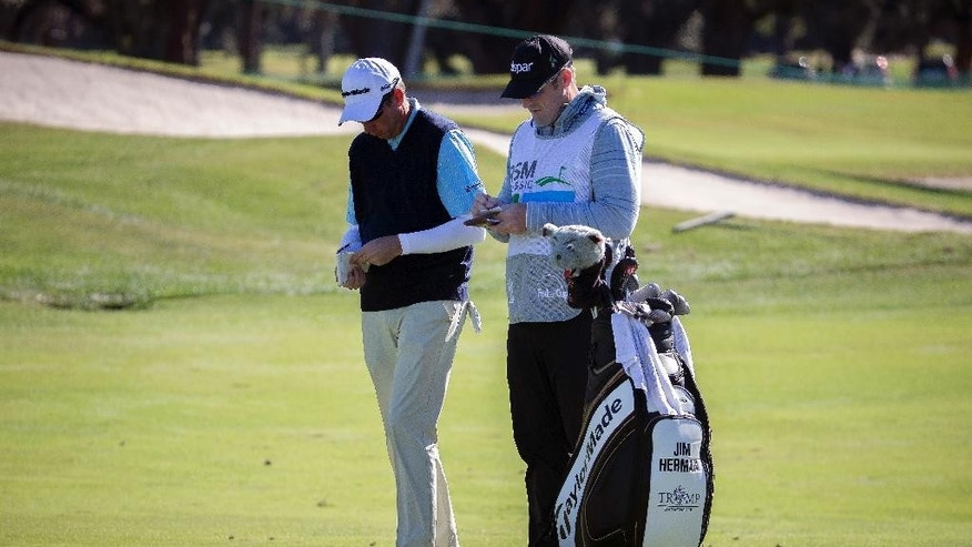 FILE - In a Sunday, Nov. 20, 2016 file photo, Jim Herman, right, and his caddie plan his shot on the first fairway during the final round at the RSM Classic golf tournament, in St. Simons Island, Ga. (AP Photo/Stephen B. Morton, File)