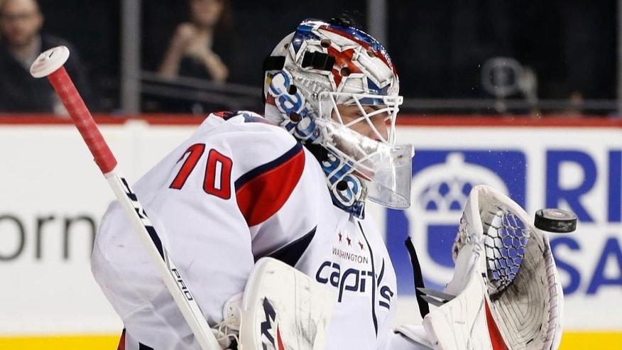 Washington Capitals' goalie Braden Holtby (70) makes a save during the second period of an NHL hockey game, Tuesday, Dec. 27, 2016, in New York. (AP Photo/Kathy Willens)