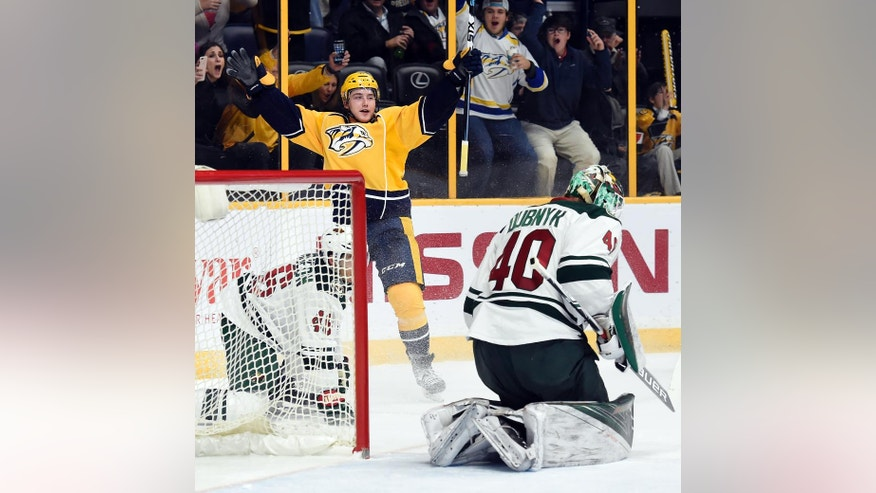 Nashville Predators center Reid Boucher (11) celebrates after scoring a goal against Minnesota Wild goalie Devan Dubnyk (40) during the second period of an NHL hockey game Tuesday, Dec. 27, 2016, in Nashville, Tenn. (AP Photo/Mark Zaleski)